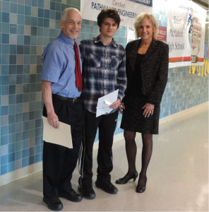 Brien McMahon student Michael Tashash won second prize in the annual Kemper Memorial Essay contest. Michael is standing with Brien McMahon principal Koroshetz and Paul Cantor president of KHREF.